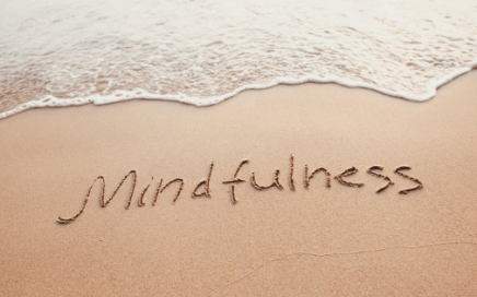 The word mindfulness written in the sand