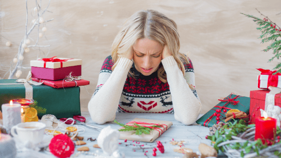 stressed lady at Christmas surrounded by presents
